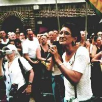 Sylvia speaking in front of the Stonewall Bar, 2002.